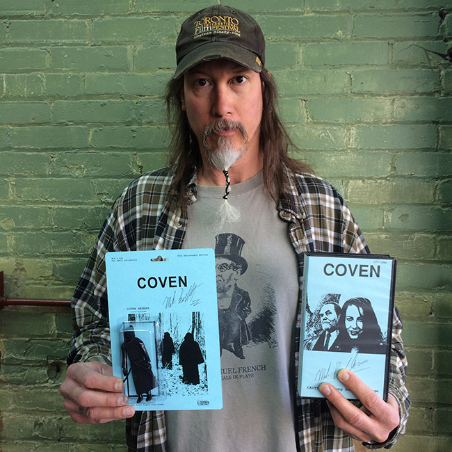 Mark Borchardt with a VHS copy of Coven and the 20th anniversary action figure